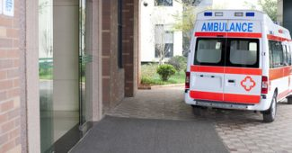 Ambulance parked in entranceway of hospital